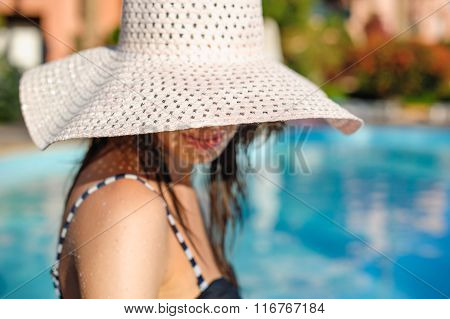 Young Woman In Big Hat Relaxing
