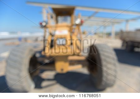Heavy grader on construction field Blur scene.