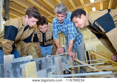 Man with three apprentices