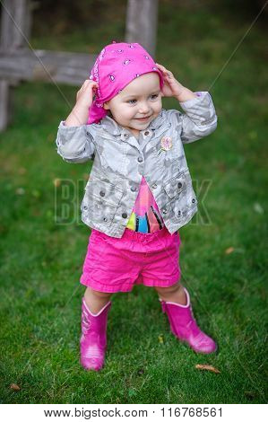 Little Girl In Pink Boots