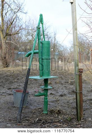 Hand Pump Leading To An Artesian Well.