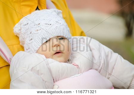 Close Up Of A Baby With A Hat Outdoors