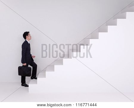 Business Man Stepping Up On Stairs
