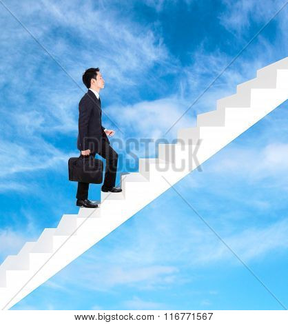 Business Man Stepping Up On Stairs With Cloud And Sky Background
