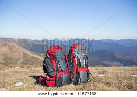 Backpack standing on top of a mountain.