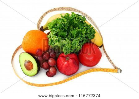 Fruits and vegetables surrounded by a heart shaped measuring tape on white background