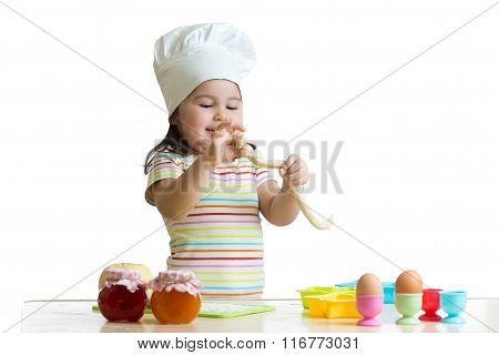 Little child girl cook playing with dough