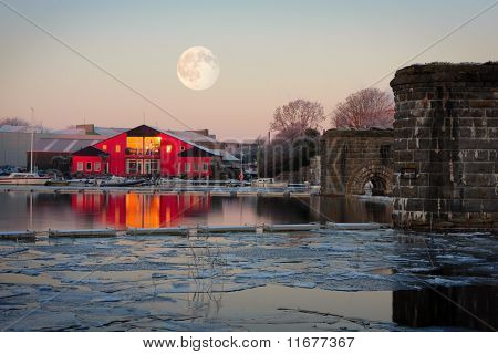 Full Moon On Top Of Rowing Club In Winter Morning