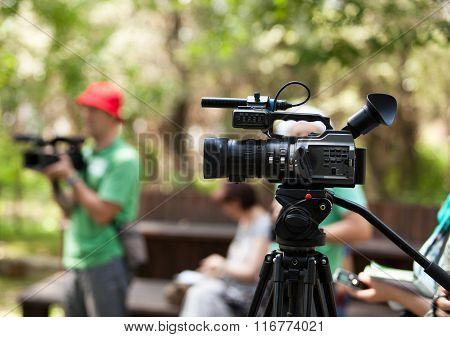 Video camera. Cameraman.