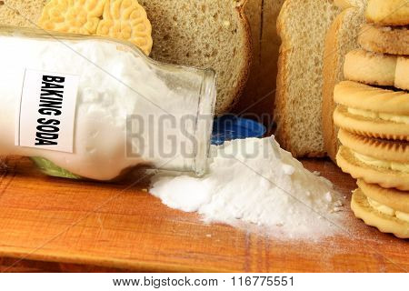 baking soda in a glass jar with cookie and bread