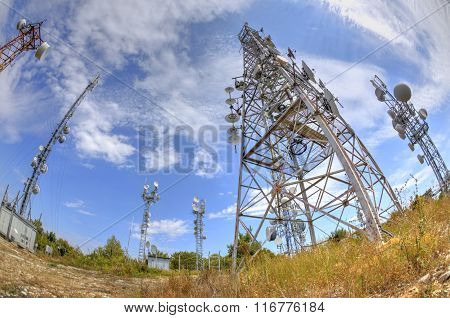 Communication antenna towers in fish-eye perspective