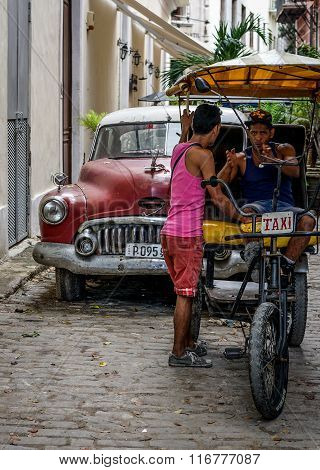 Rickshaw Bicycle Taxi And Old Car