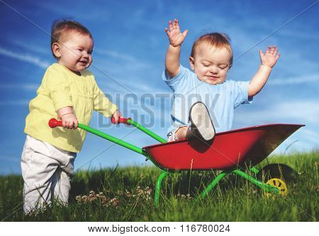 Two Toddlers Playing Together Field Outdoors Concept
