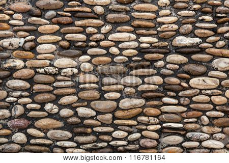 Cobbled pavement made of river rounded pebbles in Cordoba, Andalusia, Spain. Background texture.
