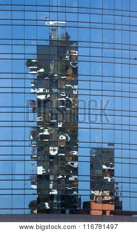 MILAN, ITALY - NOVEMBER 8, 2015: Reflection of the Bosco Verticale (Vertical Forest) residential towers in the Porta Nuova district in Milan, Lombardy, Italy.