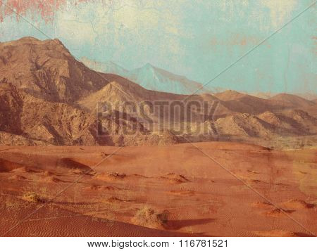 Desert landscape with mountain range and sand in retro style - barren land