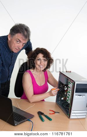 Man Looking For Woman Trainee Fixing Computer
