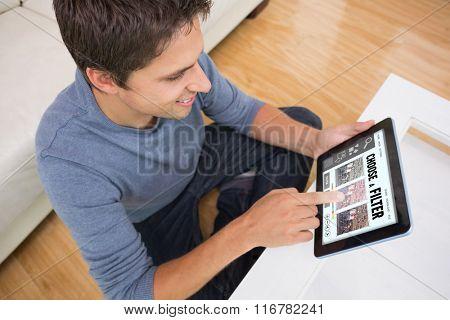 Overhead view of man using digital tablet in living room against smartphone app menu