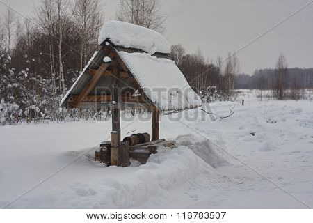 draw well in snow. white snow roofing slate winter forest. Russia