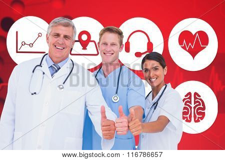 Portrait of smiling doctors with thumbs up against dna helix in blue and red with ecg line