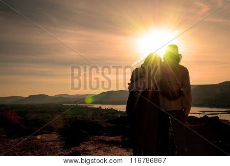 Silhouette of the lover on the hilltop