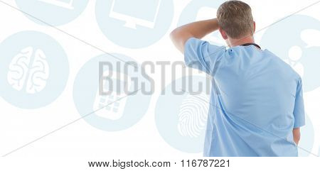 Male doctor looking through windows against multiple blue icons