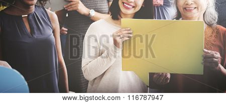 Women holding speech bubble together