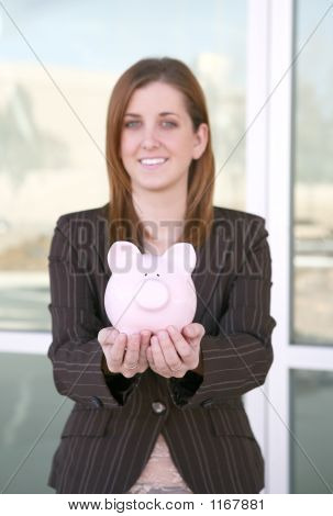 Business Woman And Bank (Focus On Piggy Bank)
