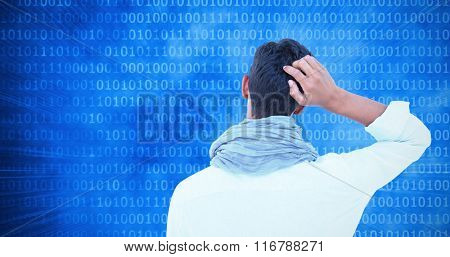 Rear view of a hipster with one hand on head against glowing futuristic binary code