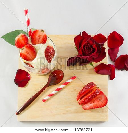 Strawberry Ice-cream, Rose Flower And Spoon On Wooden Board Composition