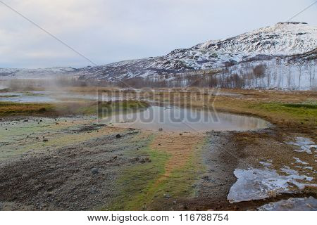 Inactive geyser in the geothermal area in Iceland