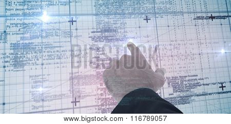 Businessman pointing with his finger against blue matrix and codes