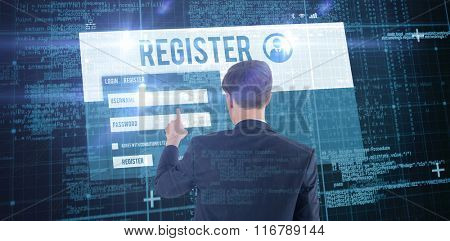 Businessman pointing something with his finger against blue matrix and codes