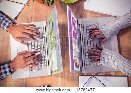 Online dating app against overhead view of hands typing on laptop keyboard