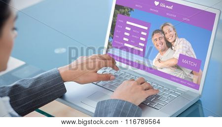 Businesswoman using laptop against online dating app
