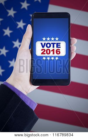 Hand Holds Cellphone With Vote Button