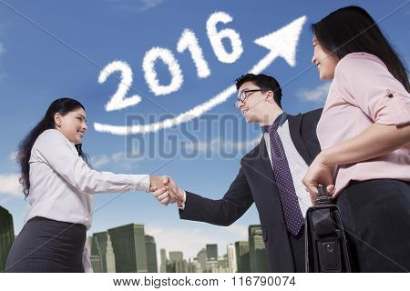 Workers Handshaking With Number 2016 Background