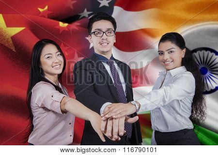 Workers With Flag Of Chinese, American, And Indian
