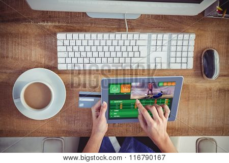 Gambling app screen against cropped image of woman using tablet