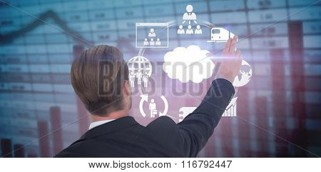 Rear view of businessman pointing with his fingers against blue data