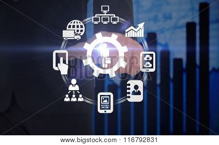 Businessman pointing with finger against blue data