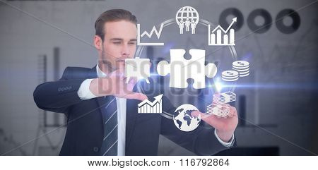 Happy businessman pointing with fingers against blue data