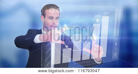 Happy businessman pointing with fingers against percentages graphical representation