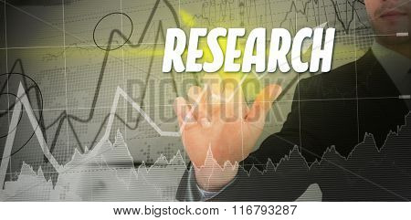 The word solution and focused businessman pointing with his finger against stocks and shares