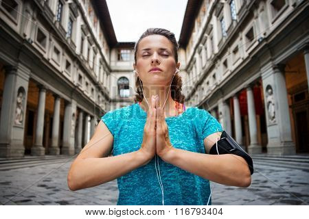 Young Fitness Woman In Sports Outfit Is Doing Yoga. Florence