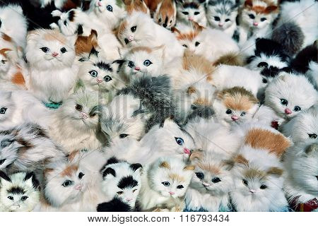 Many Small Toy Kittens Lying Together In One Heap
