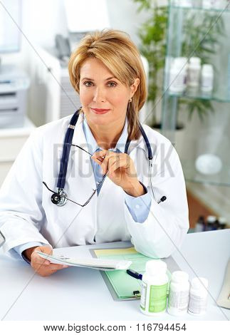 Mature doctor woman with pills.