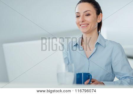 Smiling Woman Having A Coffee Break