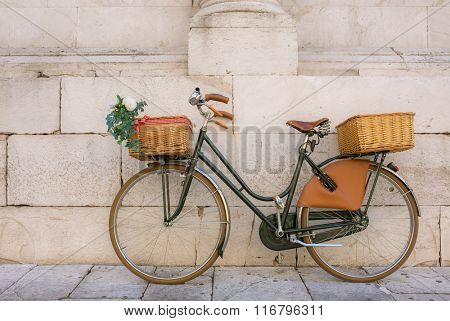 Beautiful italian bicycle with baskets