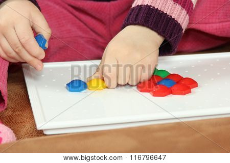 The Girl Puts A Multicolored Mosaic